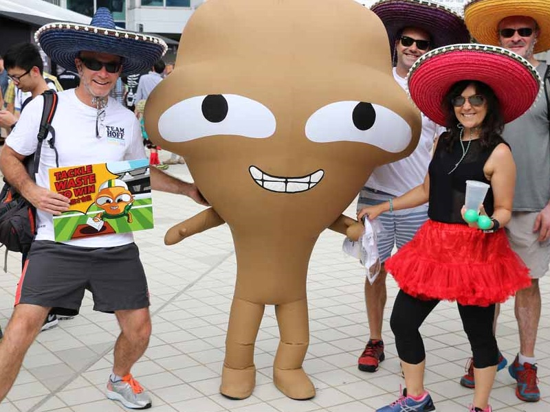 Big Waster returns to HK Sevens to promote waste reduction: Big waster with rugby 7 auidence