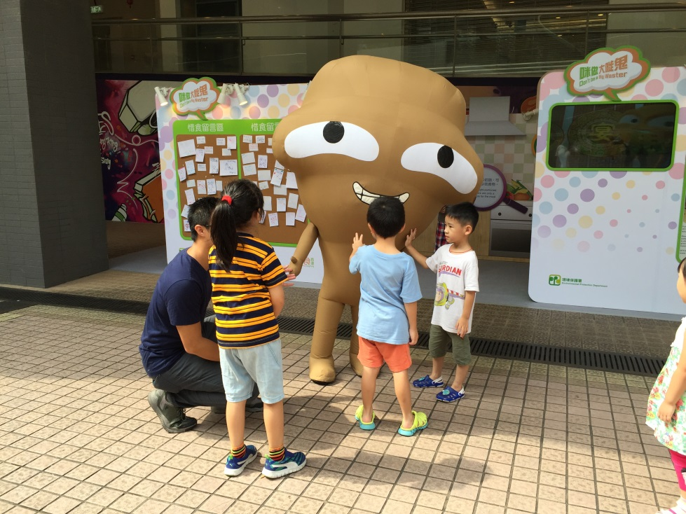 Food Wise Hong Kong Campaign to promote food waste reduction at Tuen Mun District :Big Waster interacting with children.